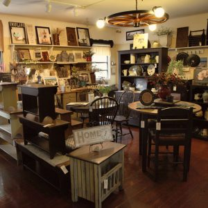 Rustic benches, dining sets, cabinets, crafts in showroom