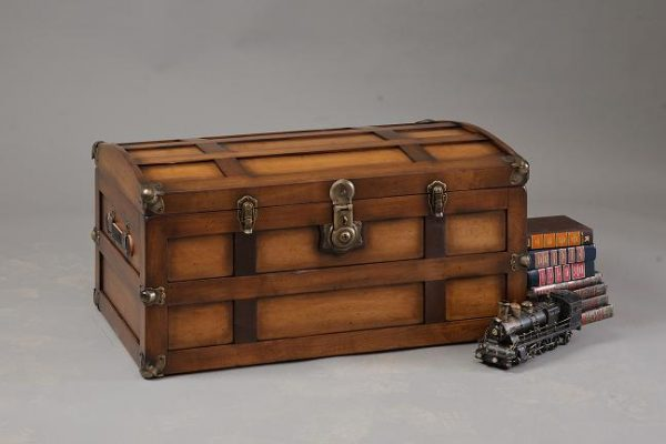 Steamer trunk with model train in front